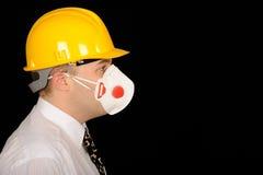 Workman wearing mask. And hardhat Stock Image