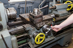 Workman working on industrial lathe Royalty Free Stock Images