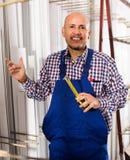 Workman working at PVC frames Stock Photos