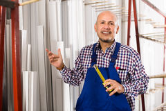 Workman working in PVC shop and smiling Royalty Free Stock Photo