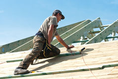 Workman working on roof royalty free stock image