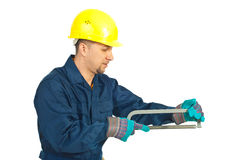 Workman working with saw. Mid adult workman working with saw isolated on white background Stock Photography