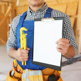 Workman with wrench Royalty Free Stock Photography