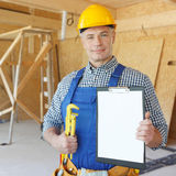 Workman with wrench Stock Photo