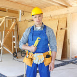 Workman with wrench Stock Images