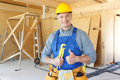 Workman with wrench Stock Image