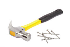 A workmans hammer & nails Stock Photography