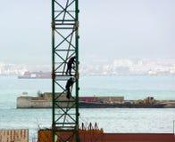 Workmen aloft Royalty Free Stock Images