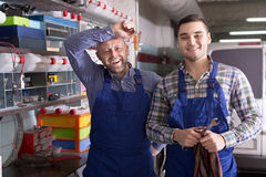 Workmen in auto repair shop Royalty Free Stock Photo