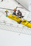 Workmen on a blueprint building site Royalty Free Stock Photo