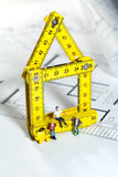 Workmen on a blueprint building site Stock Images
