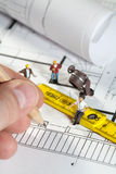 Workmen on a blueprint building site Stock Image
