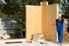 Workmen busy erecting insulated walls Stock Image