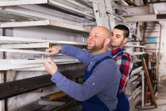 Workmen choosing PVC window profile Royalty Free Stock Photo