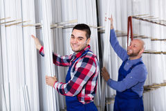 Workmen choosing PVC window profile Royalty Free Stock Photos