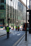 Workmen. Construction workers on the street surveying and working on a new development in London stock photo