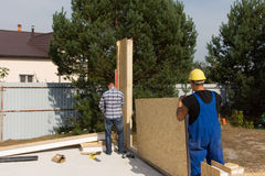 Workmen erecting wall insulation panels Stock Photos