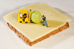 Workmen figurines making a sandwich Royalty Free Stock Images
