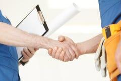 Workmen handshake Stock Photography