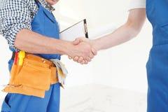Workmen handshake Royalty Free Stock Photos