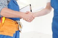 Workmen handshake Royalty Free Stock Images