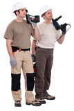 Workmen holding drills Stock Image