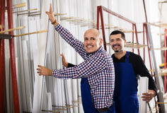Workmen inspecting PVC manufacturing output Stock Images