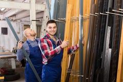 Workmen inspecting window frames Stock Photo