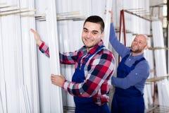 Workmen inspecting window frames Stock Photography