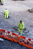 Workmen laying Cobbles Stock Photos
