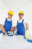 Workmen looking at house design Royalty Free Stock Photos