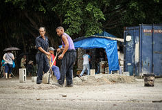 Workmen making Conrete manually Royalty Free Stock Images