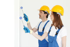 Workmen painting wall Stock Photos