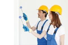 Workmen painting wall Stock Photos