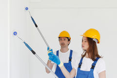 Workmen painting wall Stock Photography