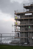 Workmen repair ballybunion castle. On the cliffs surrounded by scafolding while under repair Stock Images