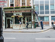 Workmen repair wires outside The Enterprise pub, Holborn, London Stock Photography