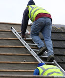 Workmen on the roof Royalty Free Stock Photography