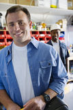 Workmen In A Shop Stock Photography