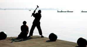 Workmen swinging hammer Stock Image
