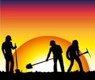 Workmen with tools. At work at sunset or sunrise Stock Photos