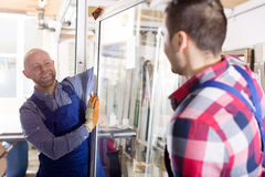 Workmen with windows production Stock Image