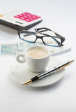 Workong environment white table or place with cup of coffee glasses pen calculator and money Royalty Free Stock Photo