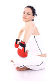 Workout. Girl in gym with boxing gloves Royalty Free Stock Images