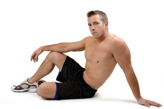 After Workout. A fitness model resting on a workout mat Royalty Free Stock Photo