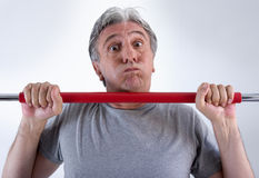 Workout. Fifty-year-old man training with difficulty Royalty Free Stock Photos