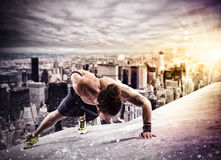 Workout  above the roof of a building in the city Stock Photos