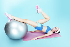 Workout. Active Woman exercising with Fitness Ball Stock Images