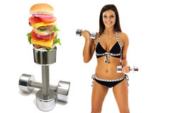 Workout burger brunette in bikini exercise. Shot of a workout burger brunette in bikini exercise Royalty Free Stock Photography