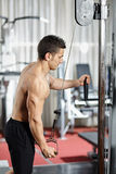 Workout at cable machine Stock Images